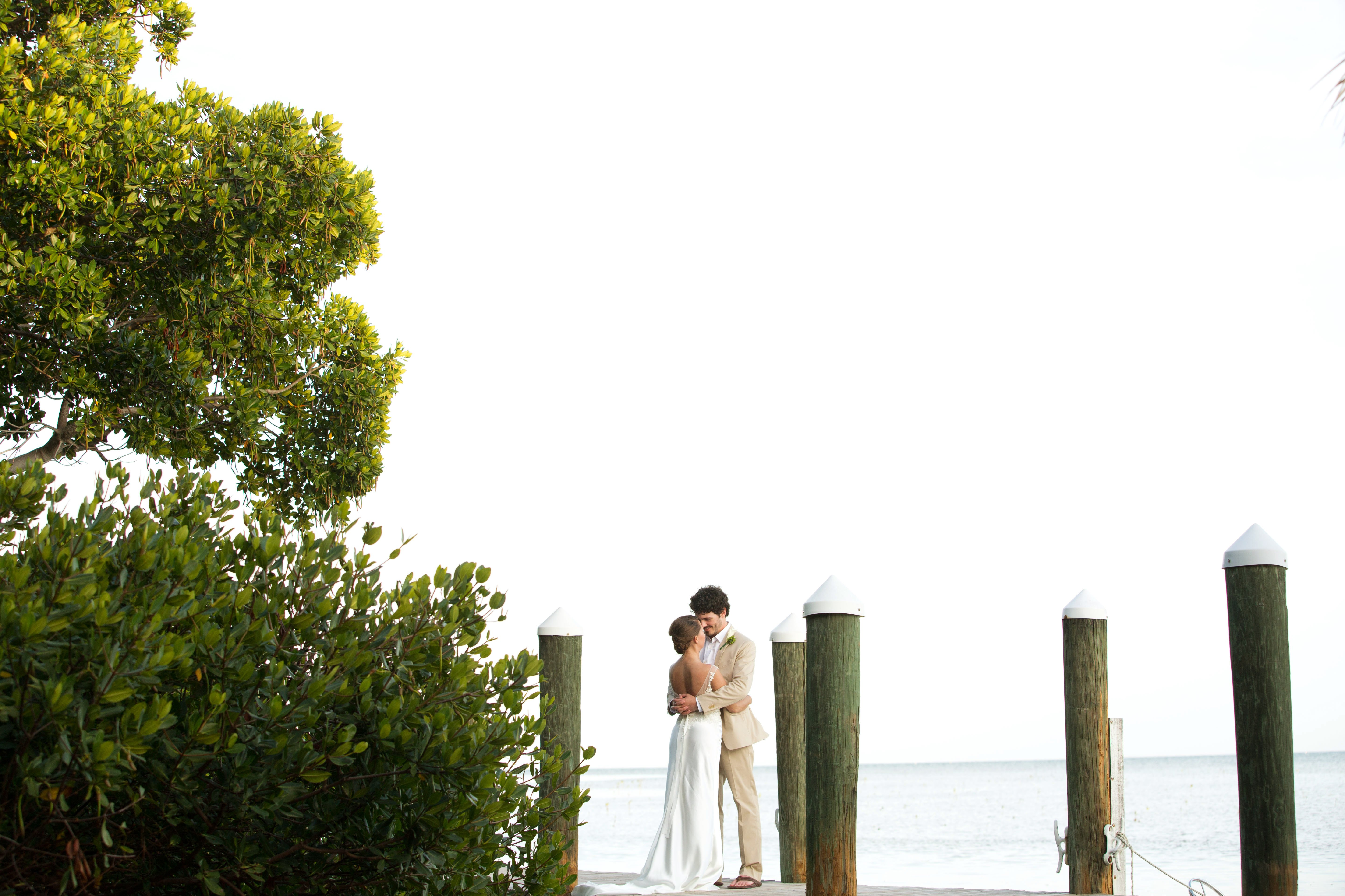 bride and groom on a pier