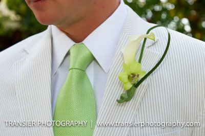 groom's boutonniere white calla lily with single green dendrobium orchid