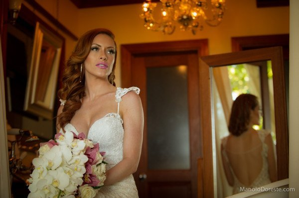 lauren in plunging backless wedding dress with bouquet