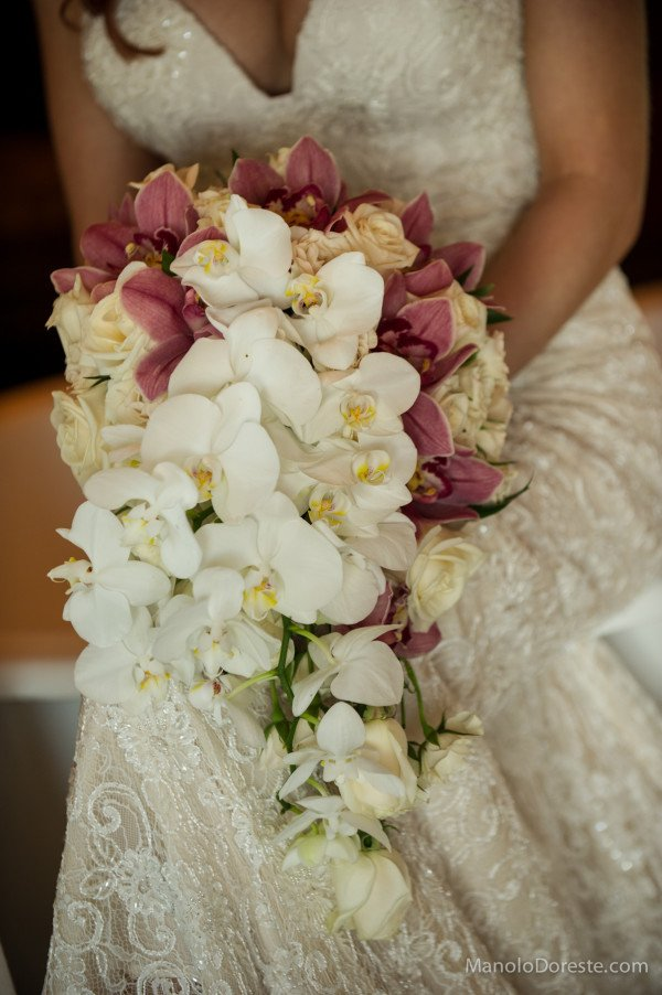 lauren's wedding bouquet with vendela roses, white spray roses, accents of light pink cymbidium orchids and phaelenopsis orchids