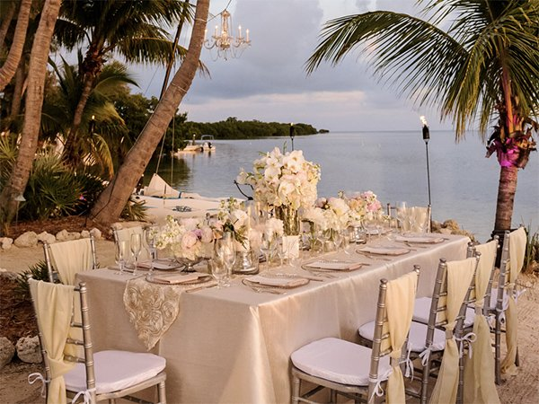 table decorated with flowers on the beach