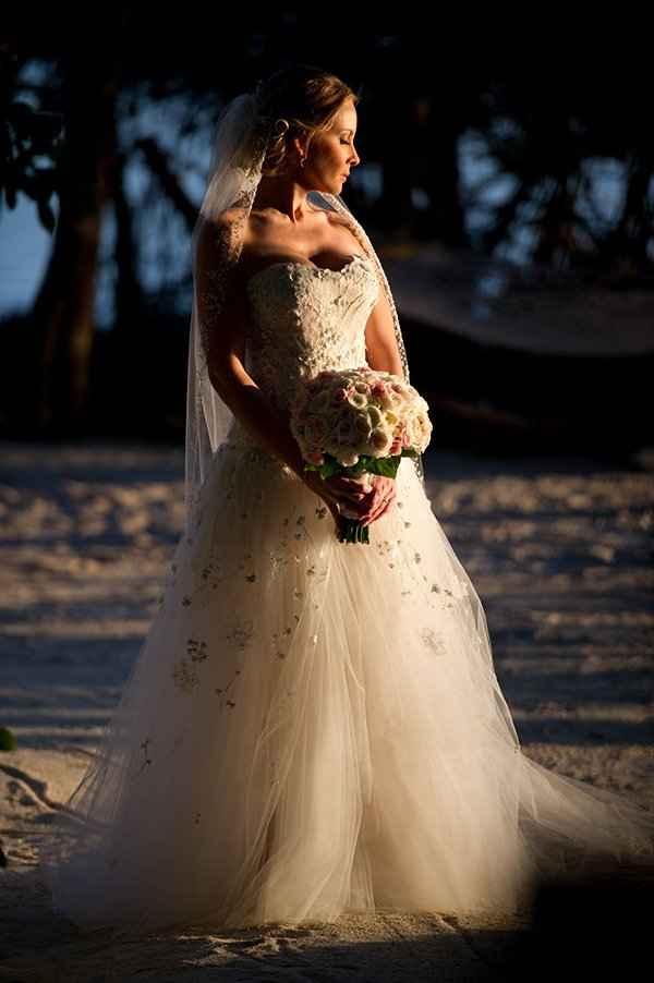 bride on the beach holding a bouqet