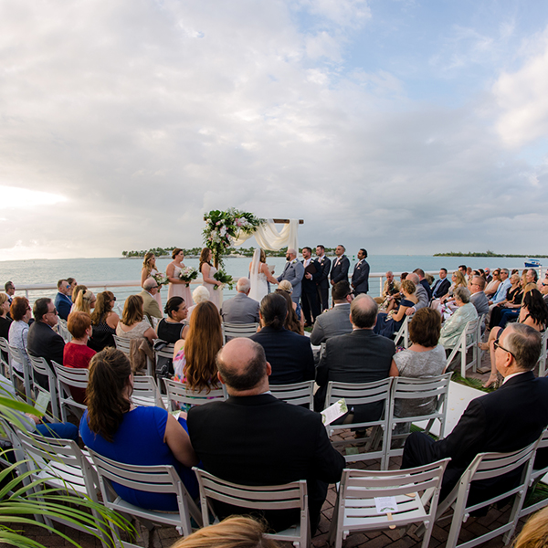 guests watching a ceremony on the water