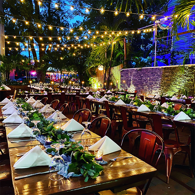 wedding reception tables with string lighting