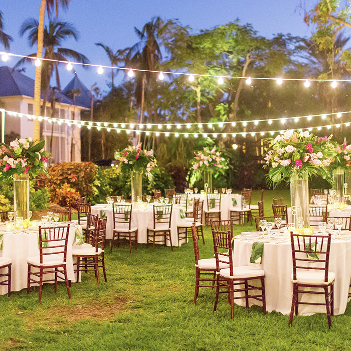 reception tables with string lighting
